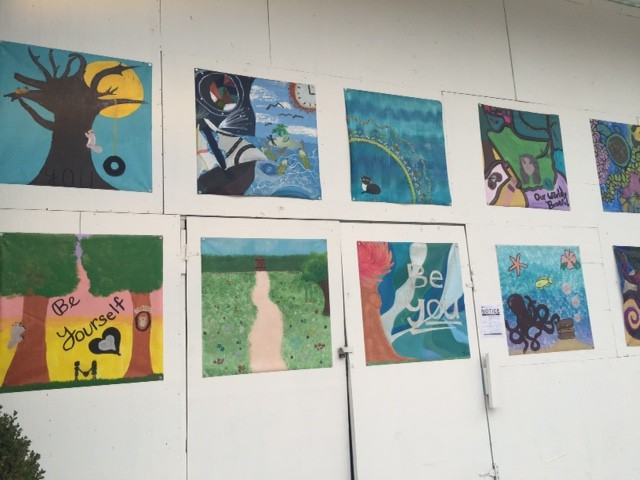 artwork on display at mosaic district shopping complex
