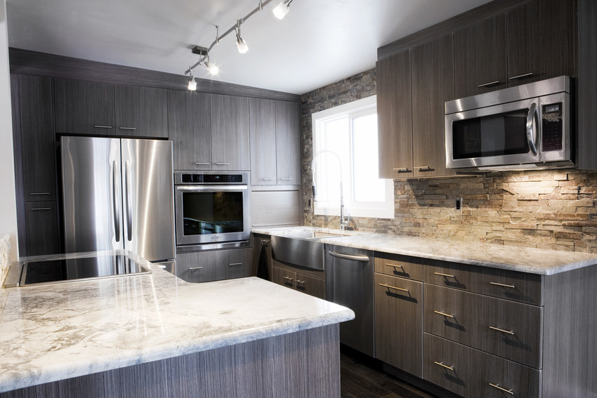 a universal design kitchen with new appliances and larger open spaces