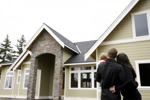 homeowners standing in front of their new house