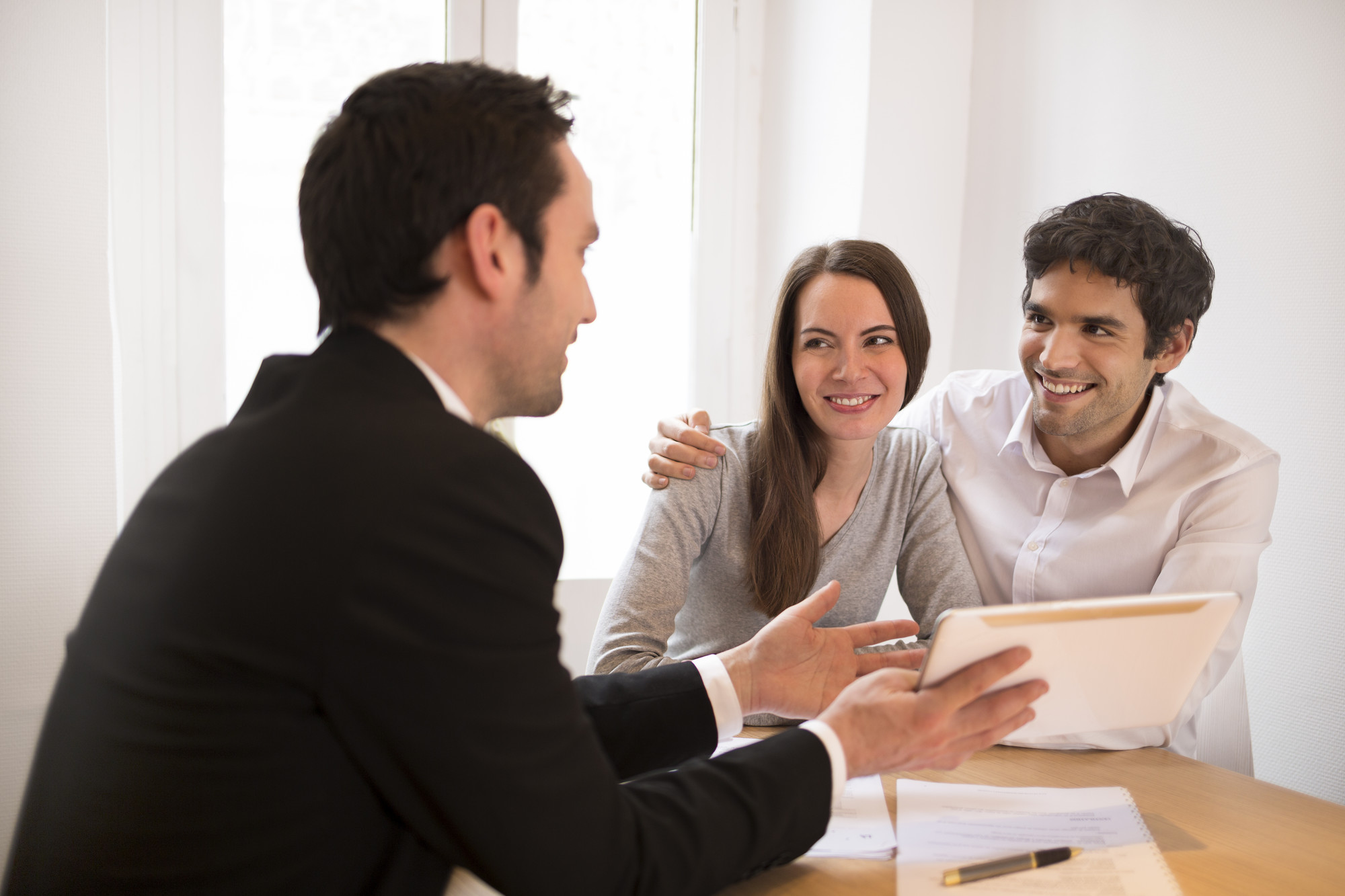buyers discussing real estate information
