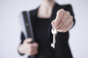 a real estate agent holding house keys
