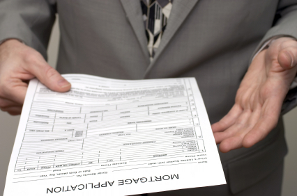 a lender holding a loan application