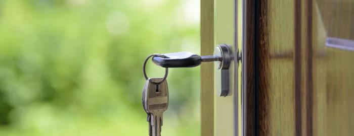 unlocking door of new home