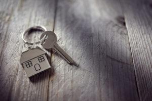house-shaped keychain next to a key